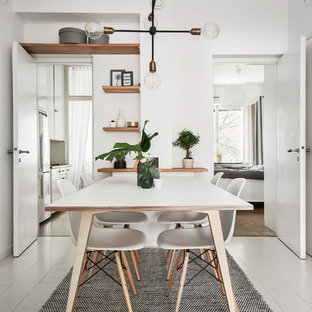 Example of a mid-sized danish painted wood floor dining room design in Stockholm with white walls