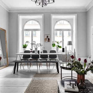 Exempel på en mellanstor minimalistisk matplats, med målat trägolv, vitt golv och grå väggar