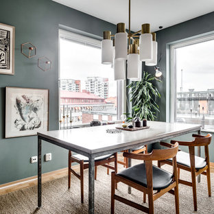 Inspiration for a mid-sized scandinavian medium tone wood floor great room remodel in Stockholm with blue walls