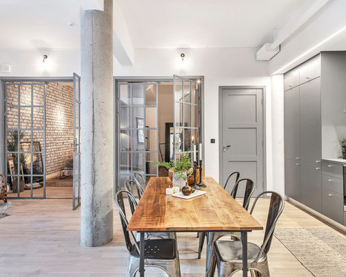 Example Of A Large Urban Light Wood Floor Great Room Design In Stockholm  With White Walls