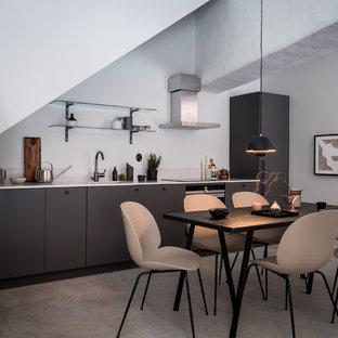 Idéer för att renovera ett mellanstort nordiskt kök med matplats, med vita väggar, betonggolv och grått golv