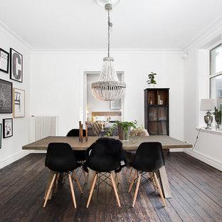 Imagen de comedor nórdico, grande, cerrado, sin chimenea, con paredes blancas y suelo de madera oscura