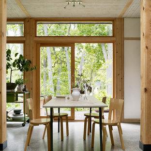 Idéer för orientaliska matplatser, med vita väggar, betonggolv och grått golv