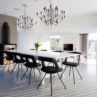Idéer för en mellanstor modern matplats med öppen planlösning, med vita väggar och betonggolv