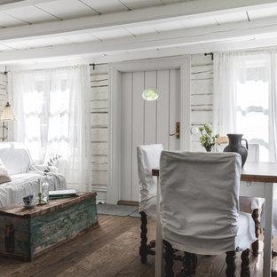 Bild på en shabby chic-inspirerad matplats med öppen planlösning, med vita väggar, mörkt trägolv och brunt golv