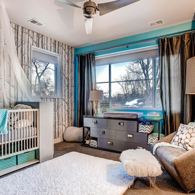 Large transitional girl carpeted nursery photo in Other with blue walls