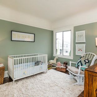 This is an example of a medium sized traditional gender neutral nursery in San Francisco with green walls, dark hardwood flooring and brown floors.
