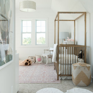 This is an example of a mid-sized contemporary nursery for girls in Kansas City with white walls, beige floor, vaulted and planked wall panelling.