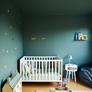Inspiration for a scandi nursery for girls in London with blue walls.