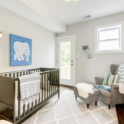 Inspiration for a transitional gender-neutral medium tone wood floor and brown floor nursery remodel in DC Metro with white walls