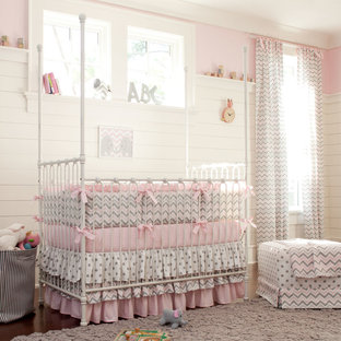 Inspiration for a traditional nursery for girls in Atlanta with pink walls.