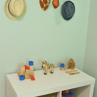 Photo of a small traditional nursery for boys in Philadelphia with blue walls and medium hardwood flooring.