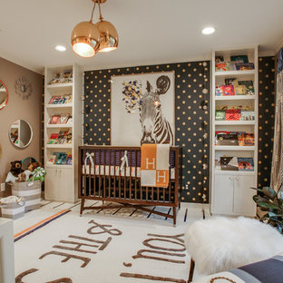 Trendy gender-neutral nursery photo in Austin with multicolored walls