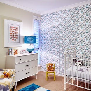 Inspiration for a contemporary gender-neutral nursery in Sydney with multi-coloured walls, carpet and orange floor.