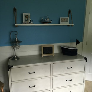 Example of a cottage chic nursery design in New York