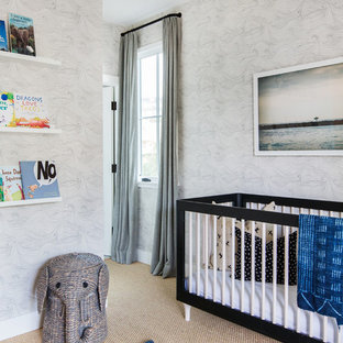This is an example of a beach style gender neutral nursery in San Diego with grey walls, carpet and beige floors.