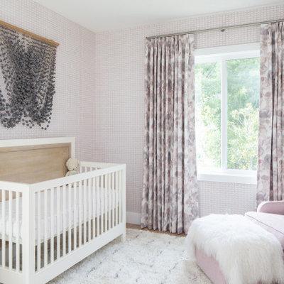 Trendy girl medium tone wood floor and brown floor nursery photo in Orange County with multicolored walls