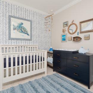 Example of a mid-sized beach style boy carpeted and beige floor nursery design in Charleston with beige walls
