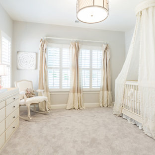 Nursery - traditional carpeted and gray floor nursery idea in Charlotte with gray walls