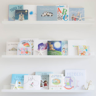 Inspiration for a medium sized beach style nursery for boys in Calgary with white walls, carpet and beige floors.