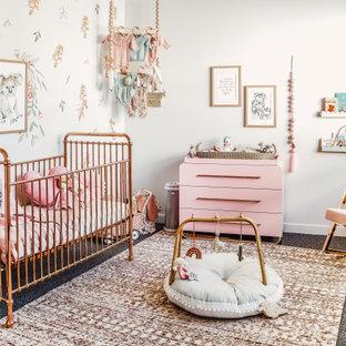 На фото: комната для малыша в стиле фьюжн с белыми стенами, ковровым покрытием, разноцветным полом и кирпичными стенами для девочки
