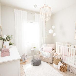 На фото: маленькая комната для малыша в стиле современная классика с серыми стенами, ковровым покрытием и бежевым полом для девочки с