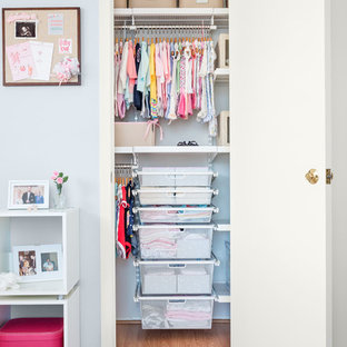 Traditional nursery in Dallas with grey walls and light hardwood floors for girls.