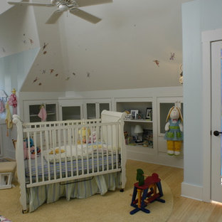 Bohemian gender neutral nursery in Other with blue walls.