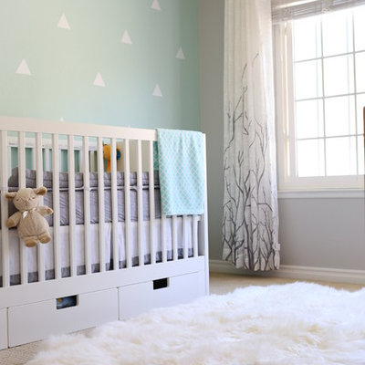 Example of a transitional gender-neutral carpeted and beige floor nursery design in San Diego with blue walls