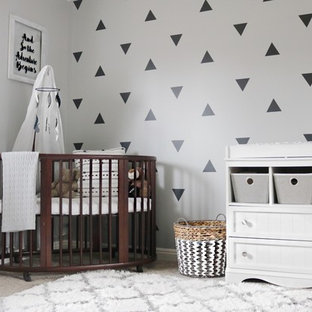 Inspiration for a large contemporary boy carpeted and beige floor nursery remodel with multicolored walls