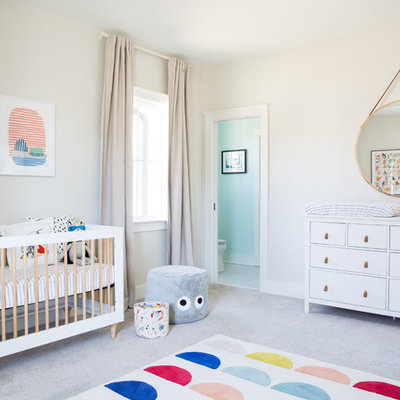 Example of a mid-sized trendy gender-neutral carpeted and gray floor nursery design in Other with beige walls