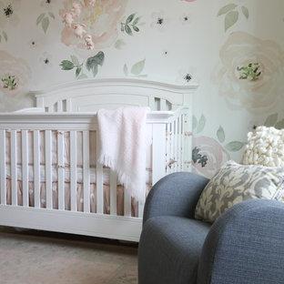 Medium sized traditional nursery for girls in Calgary with white walls, medium hardwood flooring and brown floors.