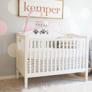 Large classic nursery for girls with multi-coloured walls, carpet and beige floors.