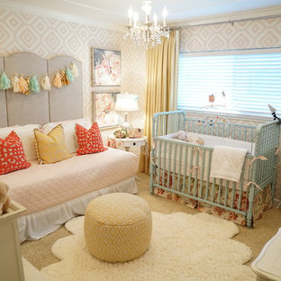This is an example of a medium sized traditional nursery for girls in San Francisco with multi-coloured walls, carpet and beige floors.