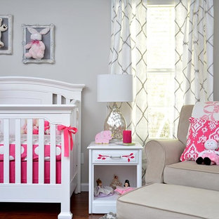 Example of a classic girl nursery design in Raleigh with gray walls