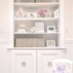 This is an example of a medium sized classic nursery for girls in New York with white walls and carpet.
