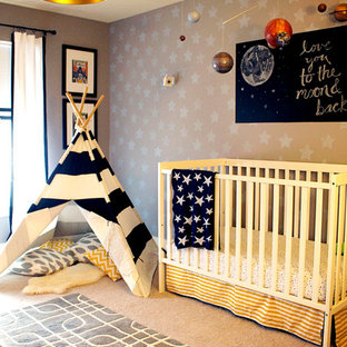 This is an example of a medium sized eclectic nursery for boys in Indianapolis with grey walls and carpet.