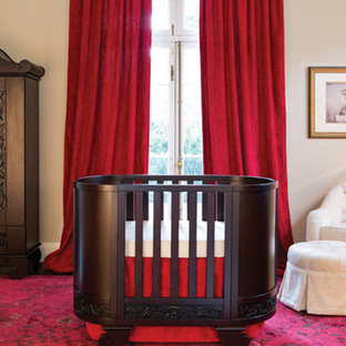This is an example of a nursery for boys in Baltimore with beige walls and dark hardwood flooring.