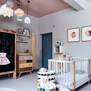 Nursery - mid-sized eclectic carpeted and gray floor nursery idea in Gloucestershire with gray walls