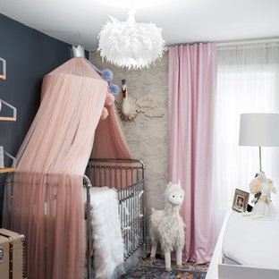 Design ideas for a bohemian nursery for girls in Philadelphia with blue walls.