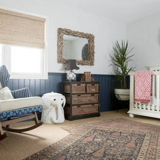 Inspiration for a beach style gender-neutral carpeted and beige floor nursery remodel in Orange County with blue walls
