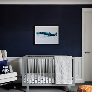 Inspiration for a nautical nursery for boys in Melbourne with blue walls, carpet and grey floors.