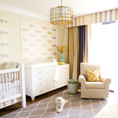 Transitional gender-neutral dark wood floor nursery photo in Los Angeles with yellow walls