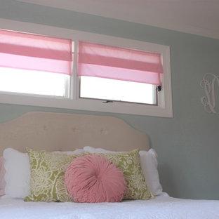 Mid-sized elegant girl medium tone wood floor nursery photo in Orange County with gray walls