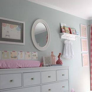 Mid-sized traditional nursery in Orange County with grey walls and medium hardwood floors for girls.