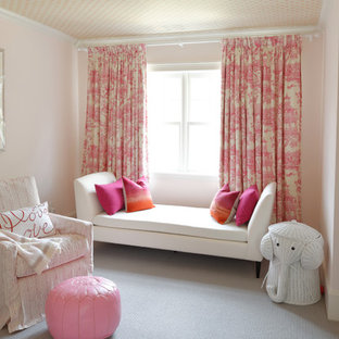 Inspiration for a mid-sized transitional girl carpeted and beige floor nursery remodel in Boston with pink walls