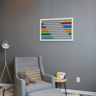Photo of a small modern nursery for boys in Austin with grey walls and dark hardwood flooring.