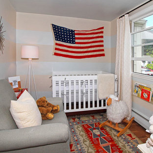 This is an example of a small eclectic nursery in Boston.