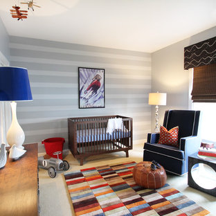 Design ideas for a medium sized bohemian nursery for boys in Charlotte with grey walls and carpet.