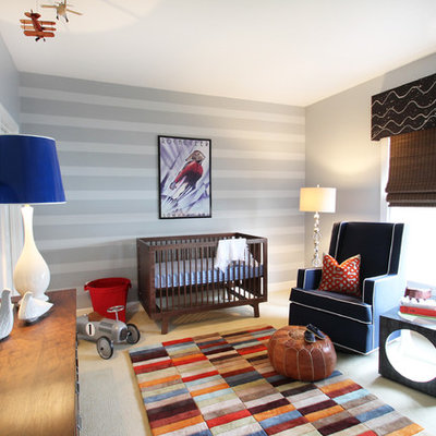 Example of a mid-sized eclectic boy carpeted nursery design in Charlotte with gray walls